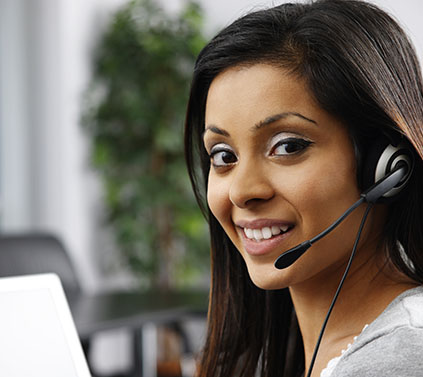 Woman on a headset smiling