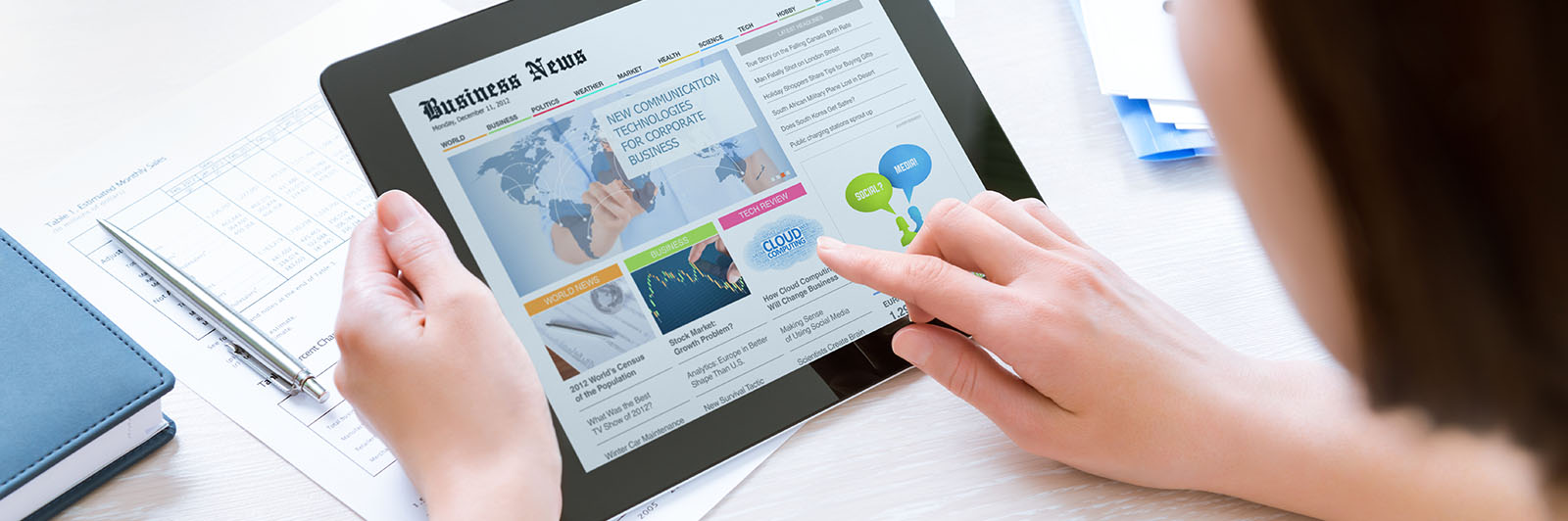 tablet with Business news on screen